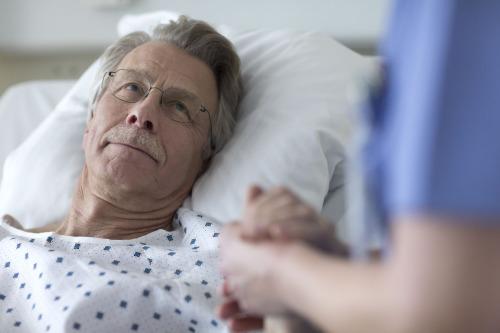 Nurse_holding_patient_hands_Tork.jpg
