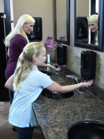 Washroom girl and woman hand washing 3.tif